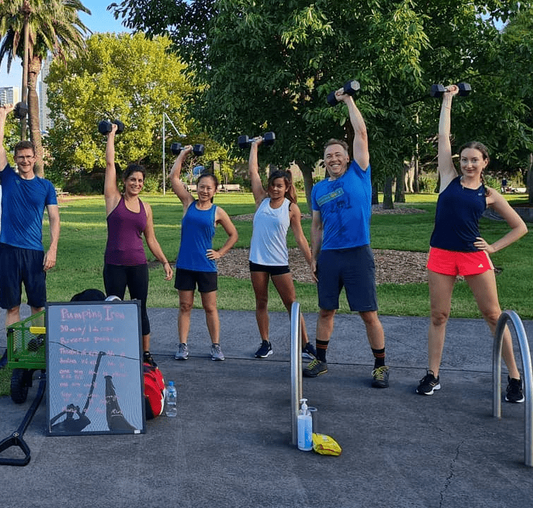 hiit group class smiling after workout