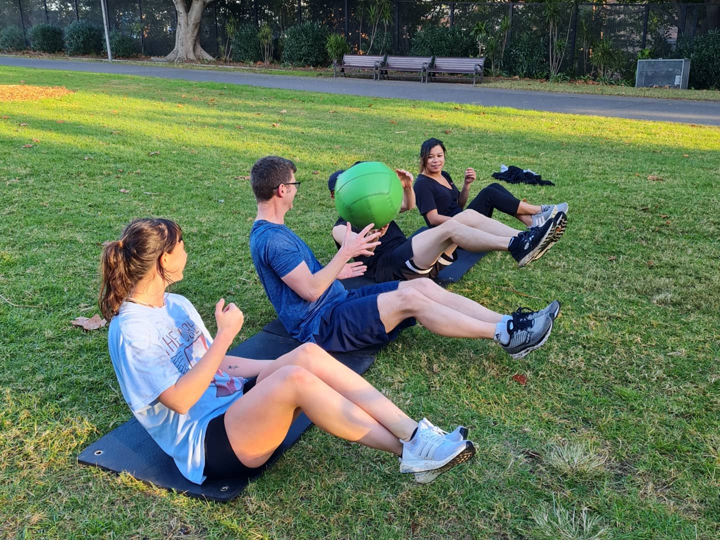 people doing abs workout outdoors